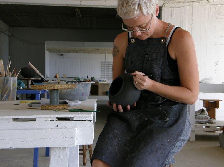 Belinda working on her pot