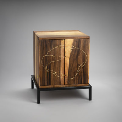 19.28 Title: Bask, 2019, Medium: handblown glass, glass engraving, walnut cabinet with brass inlay, paper, steel and LED light, Size: 52 x 44 x 44 cm, Artists: Belinda Fox and Wilfred Kalf